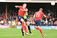 Simon Heslop of York City (8) heads the ball forward during the Vanarama National League North match between York City and Curzon Ashton at Bootham Crescent, York, England on 18 August 2018.