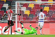 GOAL 3-0 Brentford forward Bryan Mbeumo (19) (not in picture) beats Reading goalkeeper Rafael (33) for his second goal during the EFL Sky Bet Championship match between Brentford and Reading at Brentford Community Stadium, Brentford, England on 19 December 2020.