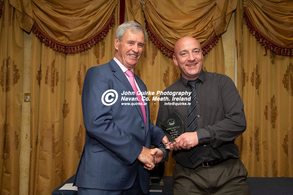 27/10/2019, Bohermeen Athletic Club 50th Anniversary celebration at the Ardboyne Hotel, Navan.<br /> Vincent Rennicks makes a presentation to Jason McMullan - Club Record Holder<br /> Photo: David Mullen / www.quirke.ie ©John Quirke Photography, Unit 17, Blackcastle Shopping Cte. Navan. Co. Meath. 046-9079044 / 087-2579454.<br /> ISO: 400; Shutter: 1/200; Aperture: 6.3; <br /> File Size: 2.8MB