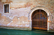 Canal and gate, Venice, Veneto, Italy