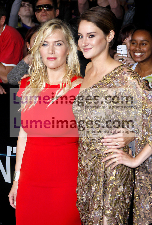 """Shailene Woodley and Kate Winslet at the Los Angeles premiere of """"Divergent"""" held at the Regency Bruin Theatre in Westwood, USA on March 18, 2014."""