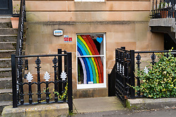 Glasgow, Scotland, UK. 3 April, 2020. Images from the soutside of Glasgow at the end of the second week of Coronavirus lockdown. Pictured; hand drawn rainbows and messages in windows of flats in Govanhill and Shawlands. Iain Masterton/Alamy Live News