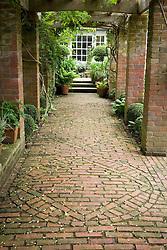 The pergola with decorative brick paving