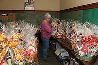 Sue Laramie puts the finishing touch on theme baskets for the annual Nutcracker Christmas Fair held November 7th - 8th at Sainte Andre Bassette Parish.  (Karen Bobotas/for the Laconia Daily Sun)