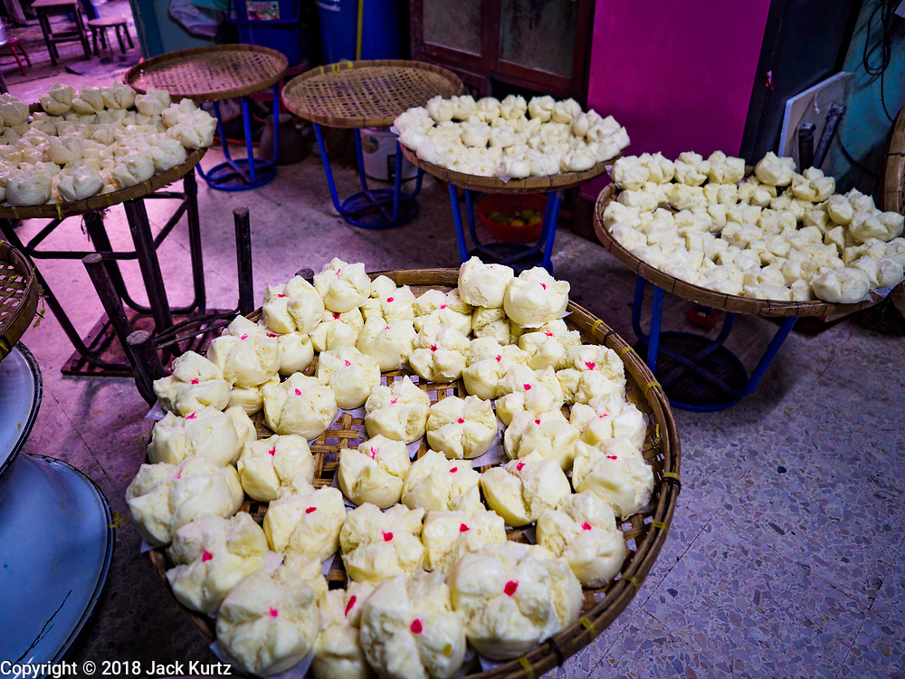 """12 FEBRUARY 2018 - BANGKOK, THAILAND: Steamed buns cool in the home of a family that makes steamed Chinese buns, called """"bao"""" in the Chinatown neighborhood of Bangkok. Bao are eaten at midnight on the Lunar New Year and served to guests during New Year's entertaining. Lunar New Year, also called Tet or Chinese New Year, is 16 February this year. The coming year will be the Year of the Dog. Thailand has a large Chinese community and Lunar New Year is widely celebrated in Thailand, especially in Bangkok and large cities with significant Chinese communities.    PHOTO BY JACK KURTZ"""