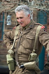 A re-enactor dressed as an officer from the British South Lancashire Regiemt  takes part in a living history display at the Elsecar Heritage Centre 1940s Wartime Weekend 4 September 2010 .Images © Paul David Drabble..
