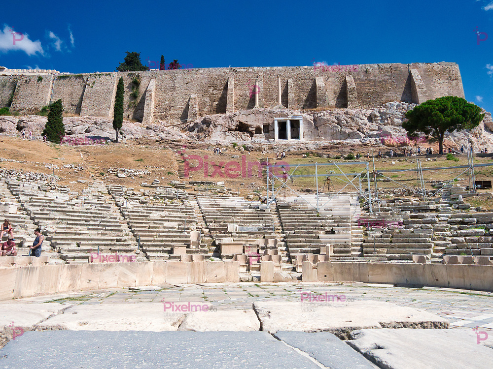 Athens, Greece - July 20, 2019 Major Theatre of Dionysus built at foot of Athenian Acropolis against blue clear sky