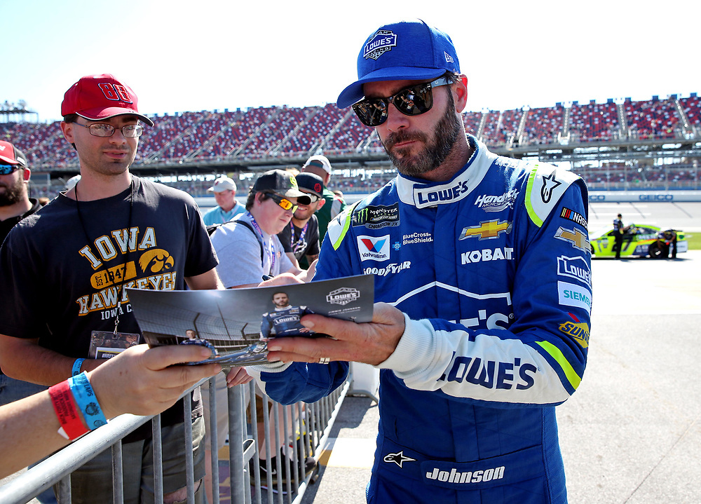 May 6, 2017; Talladega, AL, USA; NASCAR Cup Series driver Jimmie Johnson (48) signs autographa during qualifying for the GEICO 500 at Talladega Superspeedway. Mandatory Credit: Peter Casey-USA TODAY Sports