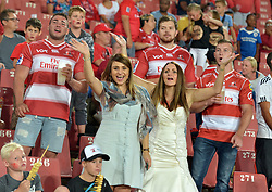 10/03/2018 Two women in a foraml and what appears to be a wedding dress caught on camera in the stands wacth Gauteng Lions vs the Auckland Blues at Emirates Airlines Stadium, Ellis Park, Johannesburg, South Africa. Picture: Karen Sandison/African News Agency (ANA)