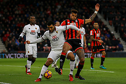 Troy Deeney of Watford and Tyrone Mings of Bournemouth battle for the ball - Mandatory by-line: Jason Brown/JMP - 21/01/2017 - FOOTBALL - Vitality Stadium - Bournemouth, England - Bournemouth v Watford - Premier League