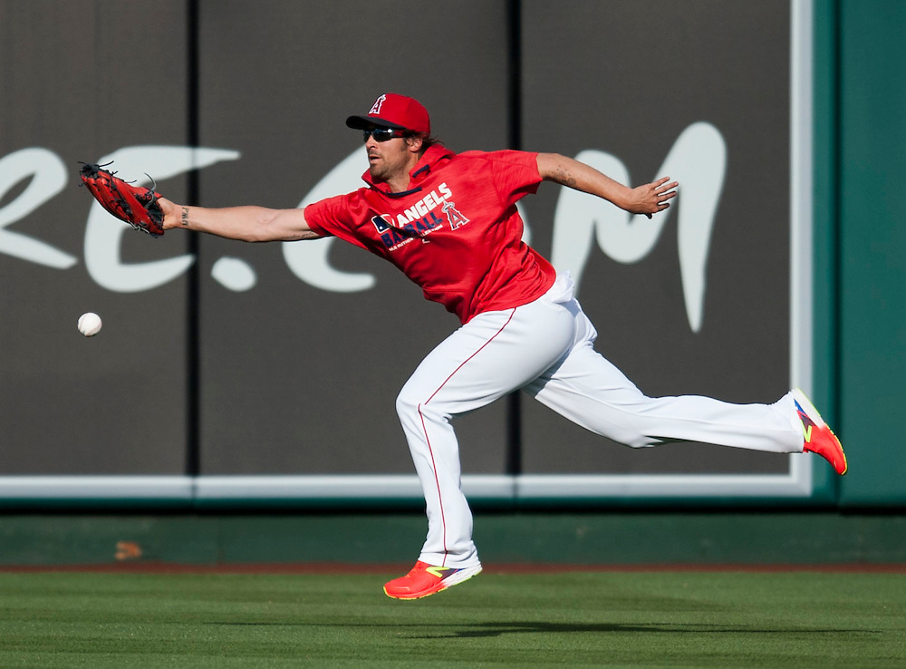 C.J. Wilson shags ball with enthusiasm before the Angels game against the Chicago Cubs at Angel Stadium Tuesday.<br /> <br /> ///ADDITIONAL INFO:   <br /> <br /> angels.0406.kjs  ---  Photo by KEVIN SULLIVAN / Orange County Register  --  4/5/16<br /> <br /> The Los Angeles Angels take on the Chicago Cubs Tuesday at Angel Stadium.<br /> <br /> <br />  4/5/16