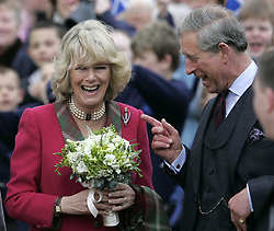 File photo dated 14/04/05 of the Prince of Wales and the Duchess of Cornwall opening a new play park in Ballater. Charles and Camilla are celebrating their 15th wedding anniversary on Friday, after they were reunited on Monday when the 72-year-old duchess came out of a 14-day self-isolation on the Balmoral estate in Aberdeenshire.