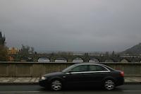 Car travelling over the bridge on River Vltava, Prague, Czech Republic<br />