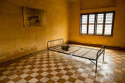 30 JANUARY 2013 - PHNOM PENH, CAMBODIA: A cell with a photo on the wall on display in the Toul Sleng Genocide Museum. The Tuol Sleng Genocide Museum is in Phnom Penh. It is a former high school that was used as the Security Prison 21 (S-21) by the Khmer Rouge from 1975 to 1979. It was used to torture and execute Cambodians and foreigners the Khmer Rouge thought were opposed to the regime.    PHOTO BY JACK KURTZ