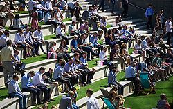 © Licensed to London News Pictures. 24/08/2016. London, UK. Office workers enjoying their lunch while sat out in the sun at Paddington Basin in  West London as warm weather across the UK continues.. Photo credit: Ben Cawthra/LNP