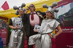 Man and women campaigning against water privatisation at the World Development Movement (WDM)'s exhibition stand at the WOMAD (World of Music; Arts and Dance) Festival in reading; 2005,