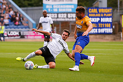 Craig Bryson of Derby County slides in to tackle Alex MacDonald of Mansfield Town - Mandatory by-line: Ryan Crockett/JMP - 18/07/2018 - FOOTBALL - One Call Stadium - Mansfield, England - Mansfield Town v Derby County - Pre-season friendly