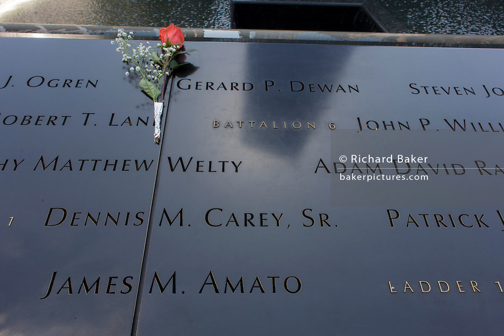 Detail of names of victims at the 9/11 Memorial in New York, killed at the locations of terrorist attacks on September 11th 2001. The National September 11 Memorial is a tribute of remembrance and honor to the nearly 3,000 people killed in the terror attacks of September 11, 2001 at the World Trade Center site, near Shanksville, Pa., and at the Pentagon, as well as the six people killed in the World Trade Center bombing in February 1993.