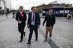 © Licensed to London News Pictures . 11/04/2015 . Bury , UK . Labour Shadow Chancellor Ed Balls (c) and James Frith (l) , Labour candidate for Bury North , at a campaign stop at The Rock shopping centre , Bury in Greater Manchester , UK . The pair met parents and discussed family finances . Photo credit : Joel Goodman/LNP