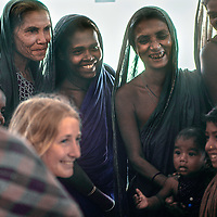 An aid worker leads a family planning discussion at Mirpur Destitute Camp, set up at an abndoned soap factory near Dhaka, Bangladesh,  after a cyclone & bloody war of independence left millions of peole homeless.  1977 image.