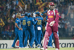© Licensed to London News Pictures. 29/09/2012. The Sri Lankan team celebrate as West Indian Chris Gayle departs during the T20 Cricket World super 8's match between Sri Lanka Vs West Indies at the Pallekele International Stadium Cricket Stadium, Pallekele. Photo credit : Asanka Brendon Ratnayake/LNP