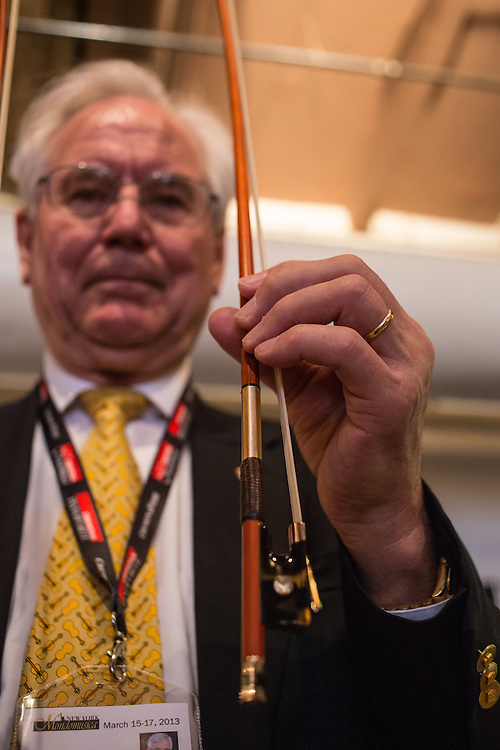 Joseph Regh, of Regh Violins, shows one of his bows. Regh was a physicist who worked for IBM, and brings his scientific training to his violin and bow making.