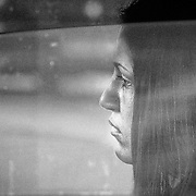Shot taken of a sad lady stuck in a traffic jam.