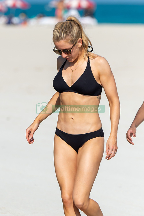 *PREMIUM EXCLUSIVE NO WEB UNTIL 0630 EST 2ND JAN* Ellie Goulding hits the beach in Miami wearing a black bikini. The 33-year-old British singer is celebrating her first New Year as a married woman in the Florida sunshine with husband Caspar Jopling. 31 Dec 2019 Pictured: Ellie Goulding. Photo credit: Splash News/MEGA TheMegaAgency.com +1 888 505 6342