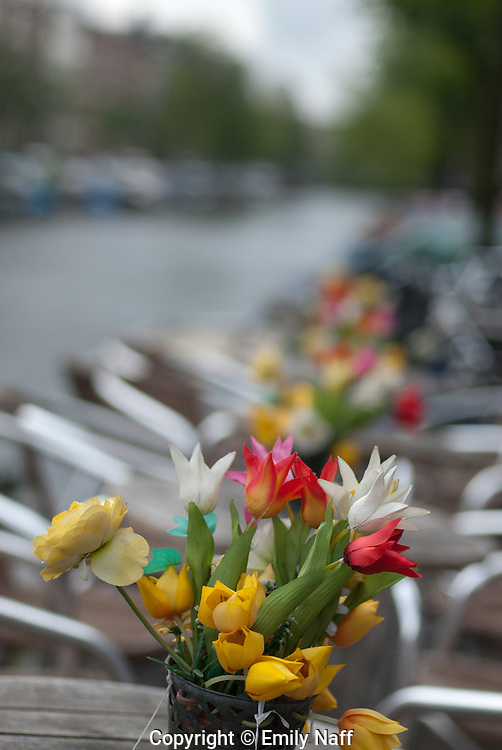 Cafe tables along the canal in Amsterdam.