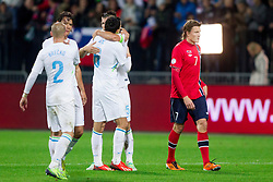 Slovenian players celebrate after the FIFA World Cup 2014 Group E qualification match between Slovenia and Norway on October 11, 2013 in Stadium Ljudski vrt, Maribor, Slovenia. (Photo by Urban Urbanc / Sportida)