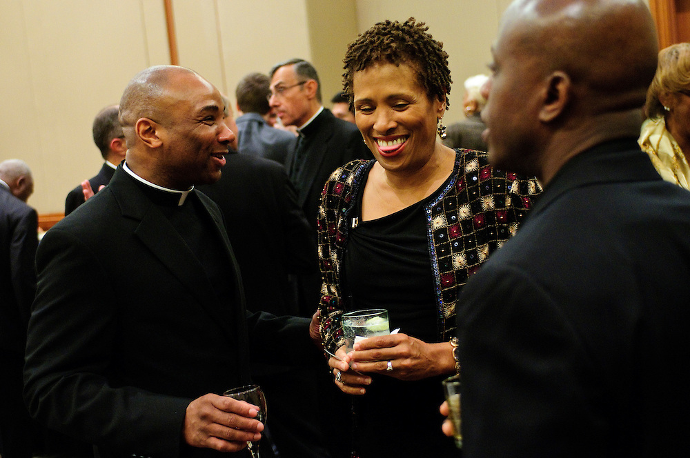 Reverend Antoine Leason of the Divine Word Missionaries (L) chats with Dr. C. Vanessa White of the Catholic Theological Union (center) during the second annual Cause for Sainthood of Father Augustus Tolton at the Hyatt Regency McCormick Place on Friday, October 19th, 2012. The event is co-sponsored by The Father Tolton Guild and the Office of Vicariate VI and Bishop Joseph Perry l Brian J. Morowczynski~ViaPhotos..For use in a single edition of Catholic New World Publications, Archdiocese of Chicago. Further use and/or distribution may be negotiated separately. ..Contact ViaPhotos at 708-602-0449 or email brian@viaphotos.com.   .The Archdiocese of Chicago's Office for Black Catholics hosts it's second annual Gala for the Cause for Sainthood of Father Augustus Tolton at the Hyatt Regency McCormick Place on Friday, October 19th, 2012. The event is co-sponsored by The Father Tolton Guild and the Office of Vicariate VI and Bishop Joseph Perry.