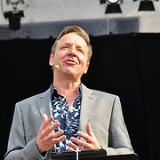Presenter Paul Rissmann for the BMW Classics + live streamed on YouTube in Trafalgar Square on a hot weather in London, UK on July 1st 2018.