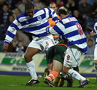 Picture: Raymond Field<br /><br />Queens Park Rangers v Plymouth Argyle nationwide league division two<br /><br />15/11/2003<br /><br />Clarke Carlisle and Marc Bircham put the brakes on Micky Evans