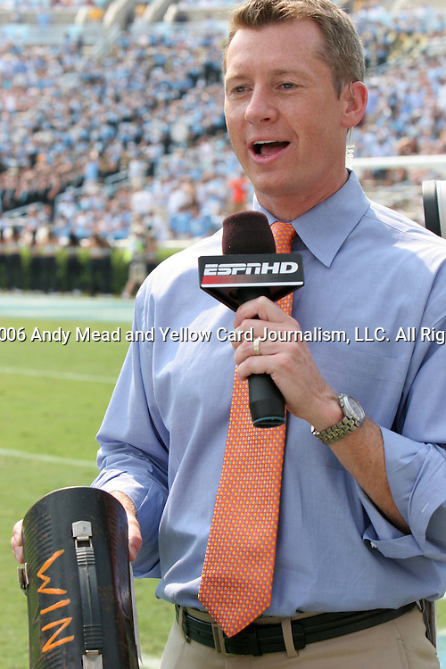 09 September 2006: ESPN sideline announcer Rob Stone holds the Virginia Tech lunch pail that the team takes with it as a lucky talisman. The University of North Carolina Tarheels lost 35-10 to the Virginia Tech Hokies at Kenan Stadium in Chapel Hill, North Carolina in an Atlantic Coast Conference NCAA Division I College Football game.