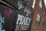 By order of the Peaky Blinders street art graffiti in Digberth, Birmingham, United Kingdom. Peaky Blinders is a British crime drama television series created by Steven Knight, that premiered on BBC Two on 12 September 2013. The series is primarily set in Birmingham, England, and follows the exploits of the Shelby crime family in the aftermath of World War I. Digbeth is an area of Central Birmingham, England. Following the destruction of the Inner Ring Road, Digbeth is now considered a district within Birmingham City Centre. As part of the Big City Plan, Digbeth is undergoing a large redevelopment scheme that will regenerate the old industrial buildings into apartments, retail premises, offices and arts facilities. There is still however much industrial activity in the south of the area.