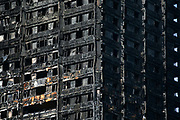 Close-up view of the burned out Grenfell Tower  June 16th 2017, London, United Kingdom. Grenfell Tower burned out after a catastophic fire killing more than 58 people. The tower caught fire early Wednesday morning and final casualty figueres may end up to be many more with police not expecting to be able to find and recover all bodies and to find all missing people. No fire sprinkler in place and cheap cladding made with plastic is so far blamed for the ferocious fire.