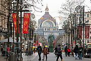 The Meir shopping street in Antwerpen, Belgium. The central train station in the background