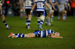 Bath Scrum-Half (#9) Peter Stringer lays flat out after an apparant takes a high ball tackle from Saracens Flanker (#7) Jacques Burger - Photo mandatory by-line: Rogan Thomson/JMP - 07966 386802 - 28/02/2014 - SPORT - RUGBY UNION - The Recreation Ground, Bath - Bath Rugby v Saracens - Aviva Premiership.