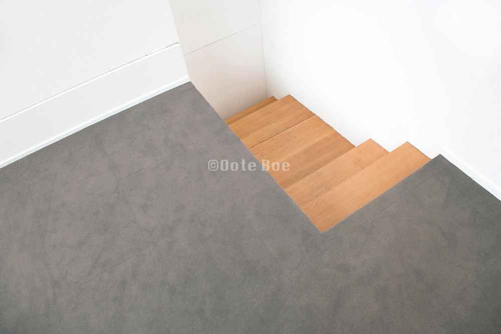 floor with stairs leading to wall