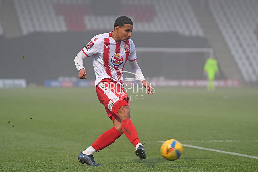 Stevenage defender Luther Wildin(2) misses the target during the FA Cup match between Stevenage and Swansea City at the Lamex Stadium, Stevenage, England on 9 January 2021.