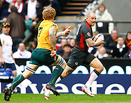 Mike Tindall of England runs past David Pocock of Australia during the Investec series international between England and Australia at Twickenham, London, on Saturday 13th November 2010. (Photo by Andrew Tobin/SLIK images)