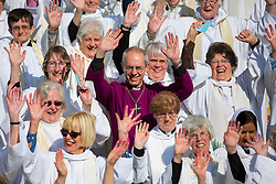 © licensed to London News Pictures. London, UK 03/05/2014. More than 500 women priests who ordained in 1994 and the Archbishop of Canterbury posing for a picture outside St Paul's Cathedral to mark the twentieth anniversary of women becoming ordained priests in the Church of England. Photo credit: Tolga Akmen/LNP