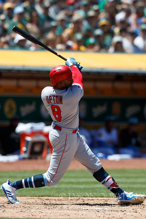 OAKLAND, CA - JUNE 17: Justin Upton #8 of the Los Angeles Angels of Anaheim at bat against the Oakland Athletics during the fifth inning at the Oakland Coliseum on June 17, 2018 in Oakland, California. The Oakland Athletics defeated the Los Angeles Angels of Anaheim 6-5 in 11 innings. (Photo by Jason O. Watson/Getty Images) *** Local Caption *** Justin Upton