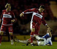 Photo: Jed Wee.<br /> Middlesbrough v Nuneaton Borough. The FA Cup. 17/01/2006.<br /> <br /> Middlesbrough's Mark Viduka gets entangled in the legs of Nuneaton's Michael Love.