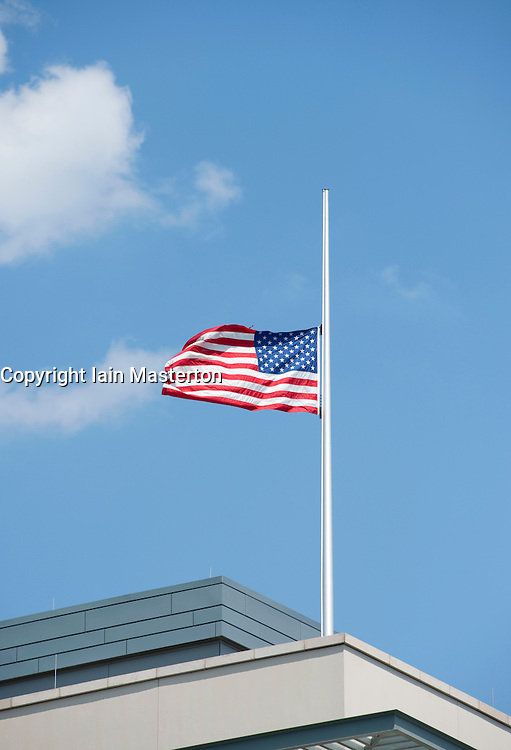 United States of America flag flying at half mast above American Embassy in Berlin Germany