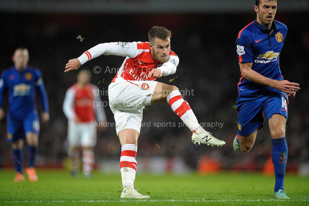 Aaron Ramsey of Arsenal taking a shot. Barclays Premier league match, Arsenal v Manchester Utd at the Emirates Stadium in London on Saturday 22nd November 2014.<br /> pic by John Patrick Fletcher, Andrew Orchard sports photography.