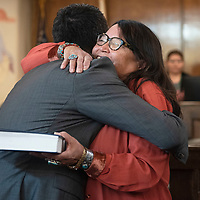 Faith Roessel hugs her son Carl Roessel Slater after he is  sworn in to the 24th Navajo Nation Council as the Council Delegate for the Tsaile/Wheatfields, Lukachukai, Round Rock, Tséch'izhí and Rock Point Chapters at the Navajo Nation Council Chamber on October 10 in Window Rock.