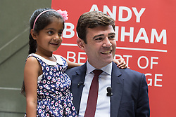 © Licensed to London News Pictures . 17/08/2015 . Manchester , UK . ANDY BURNHAM with ARMEET UPPAL (eight , from Huddersfield) , the child of a supporter , after delivering a speech at the People's History Museum in Manchester this morning (Monday 17th August 2015) . Photo credit : Joel Goodman/LNP