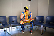 Milpitas High School Special Education one-on-one aid Erich Guglielmelli enjoys a snack in his Wolverine costume during the Santa Clara County Super Hero Dance at Milpitas High School in Milpitas, California, on April 18, 2014. (Stan Olszewski/SOSKIphoto)