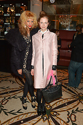 Left to right, JOY VIELI and ANNA PARKINSON at a dinner hosted by Amy Molyneaux and Percy Parker of fashion label PPQ to celebrate the PPQ AW 2015 collection 'Persephone' held at Braserie Chavot, 41 Conduit Street, London on 22nd February 2015.